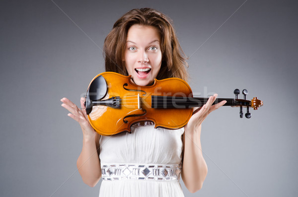 Woman artist with violin in music concept Stock photo © Elnur
