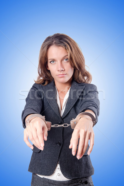Female businesswoman with handcuffs against gradient  Stock photo © Elnur