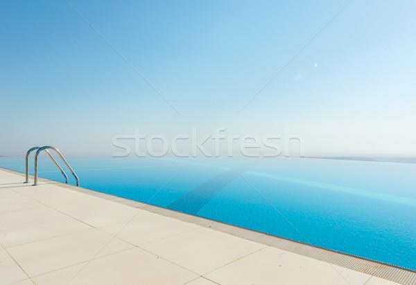 Végtelen medence fényes nyár nap égbolt Stock fotó © Elnur