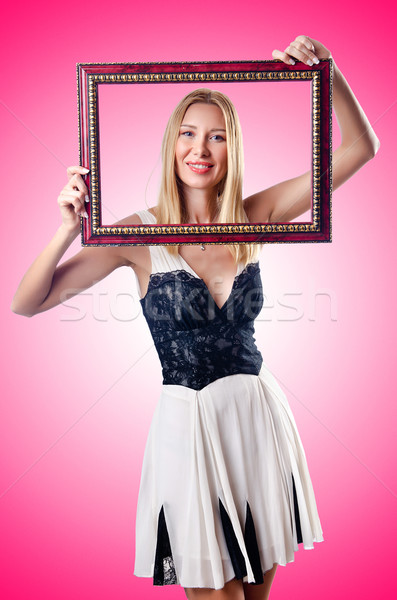 Young woman with picture frame on white Stock photo © Elnur