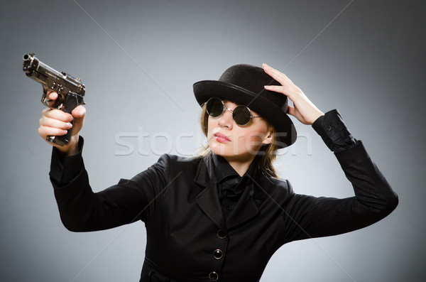женщины шпиона оружием серый стороны красоту Сток-фото © Elnur