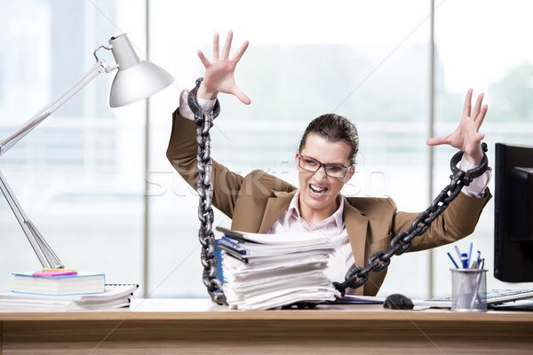 The woman chained to her working desk Stock photo © Elnur