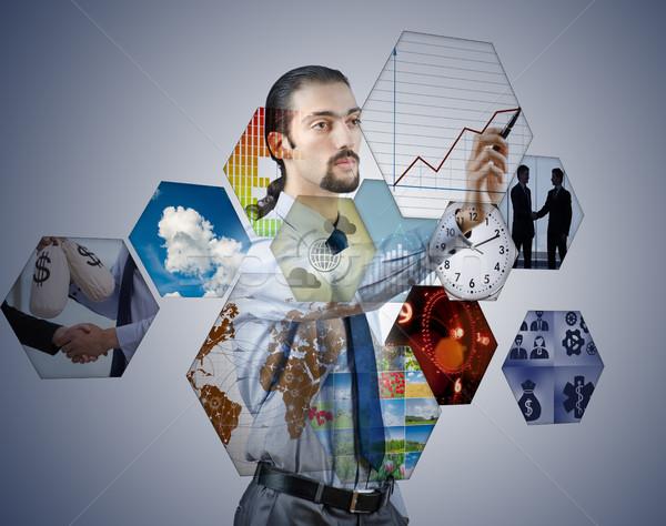 üzletember kisajtolás virtuális gombok üzlet pénz Stock fotó © Elnur