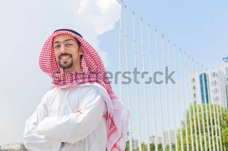 Arab man with his mobile phone isolated on white Stock photo © Elnur