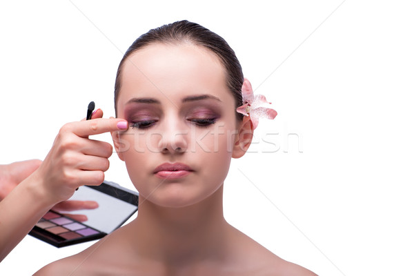 Beautiful woman during make-up cosmetics session isolated on whi Stock photo © Elnur