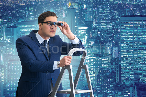 Businessman with binoculars on the stairs ladder Stock photo © Elnur