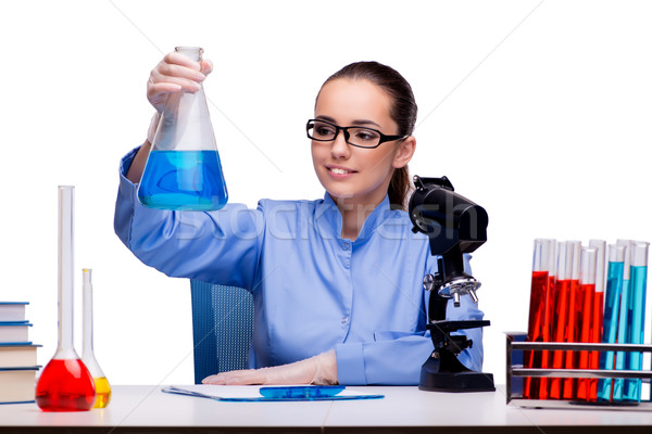 The lab chemist working with microscope and tubes Stock photo © Elnur