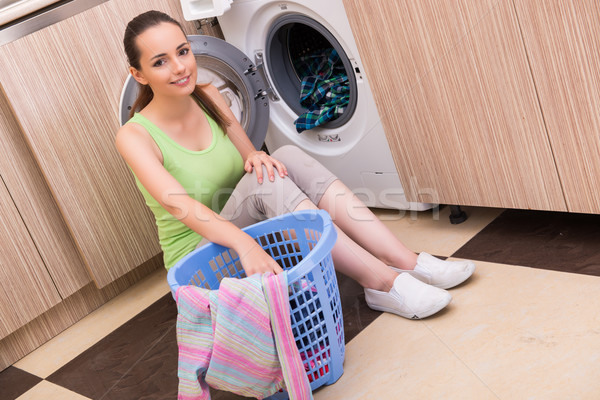 Young wife woman washing clothes near machine Stock photo © Elnur