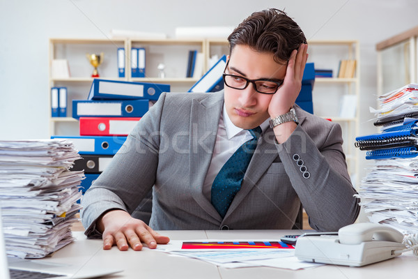 Businessman busy with much paperwork Stock photo © Elnur