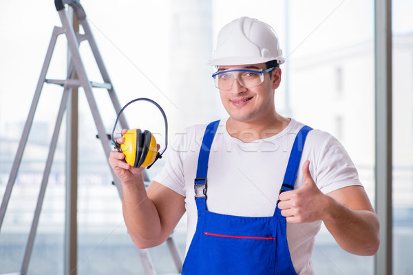The young worker with noise cancelling headphones Stock photo © Elnur