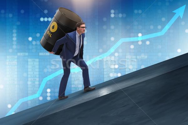 The businessman under the burden of oil barrel Stock photo © Elnur