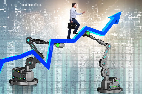 The businessman walking up the chart supported by robotic arm Stock photo © Elnur