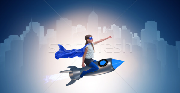 Little girl flying rocket in superhero concept Stock photo © Elnur