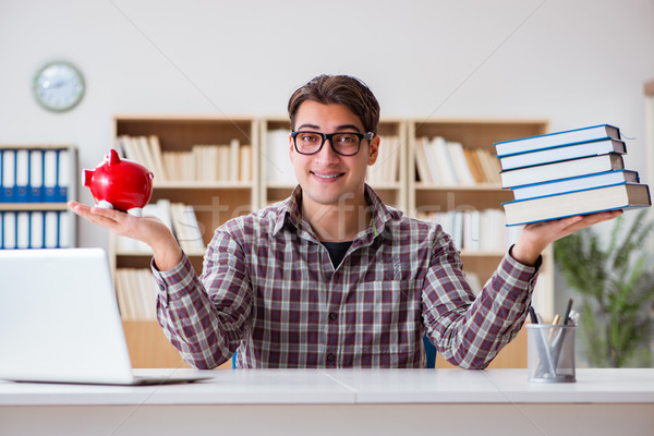 Student breaking piggybank to pay for tuition fees Stock photo © Elnur
