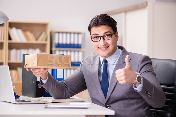 Businessman receiving parcel in the office Stock photo © Elnur