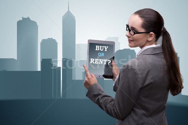 Businesswoman facing dilemma of buying versus renting Stock photo © Elnur