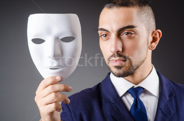 Man with mask in the dark Stock photo © Elnur