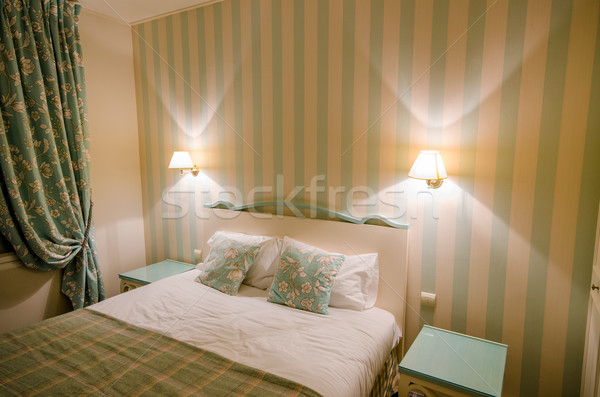 Hotel room with double bed Stock photo © Elnur