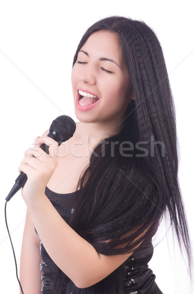 Young female singer with mic on white Stock photo © Elnur