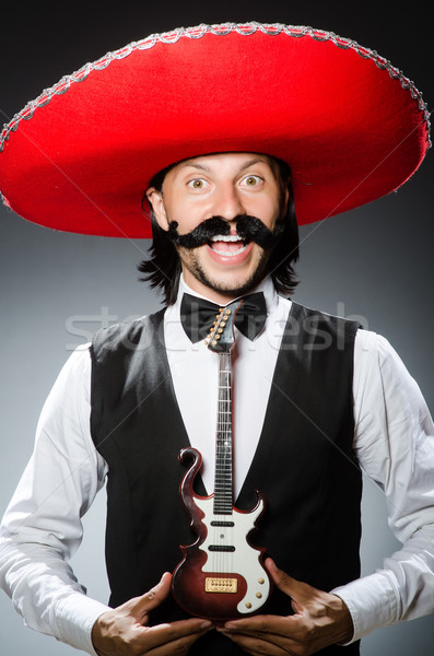 Mexican man with guitar in music concept Stock photo © Elnur