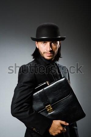 Férfi visel klasszikus kalap fegyver üzlet Stock fotó © Elnur
