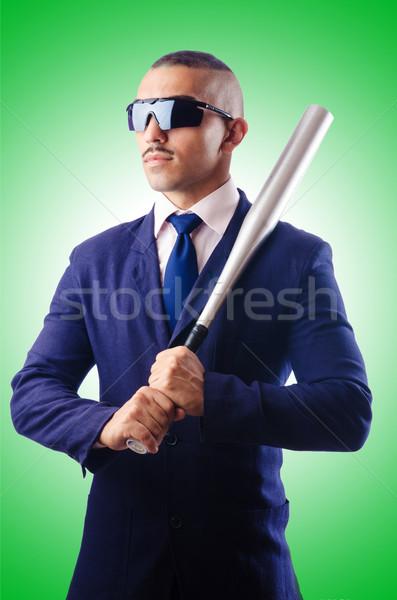 Handsome businessman with bat on white Stock photo © Elnur