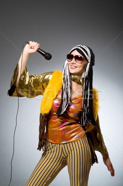 Musical mujer fiesta pelo fondo micrófono Foto stock © Elnur