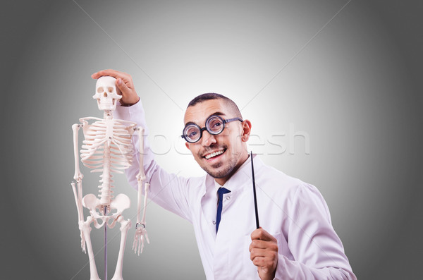 Funny doctor with skeleton against the gradient Stock photo © Elnur