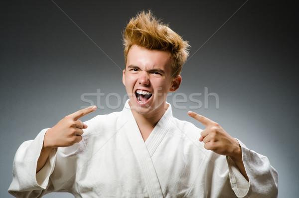 Divertente karate combattente indossare bianco kimono Foto d'archivio © Elnur