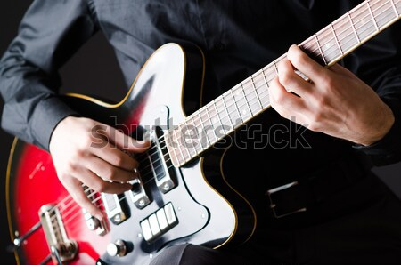 Man with guitar during concert Stock photo © Elnur