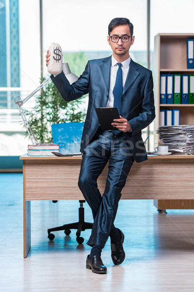 The happy businessman with money sacks in the office Stock photo © Elnur