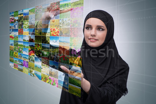 Arabian woman pressing virtual button on nature collage Stock photo © Elnur