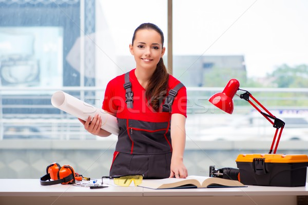 Young woman in coveralls doing repairs Stock photo © Elnur