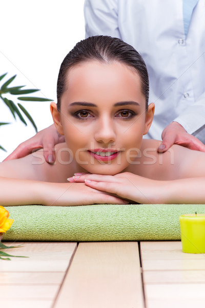 Woman during massage session in spa salon Stock photo © Elnur