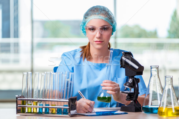 The young student working with chemical solutions in lab Stock photo © Elnur