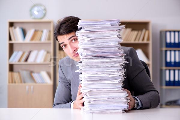 Businessman struggling to meet challenging deadlines Stock photo © Elnur