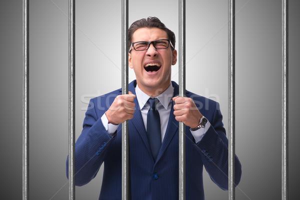 Foto stock: Jovem · empresário · atrás · barras · prisão · negócio