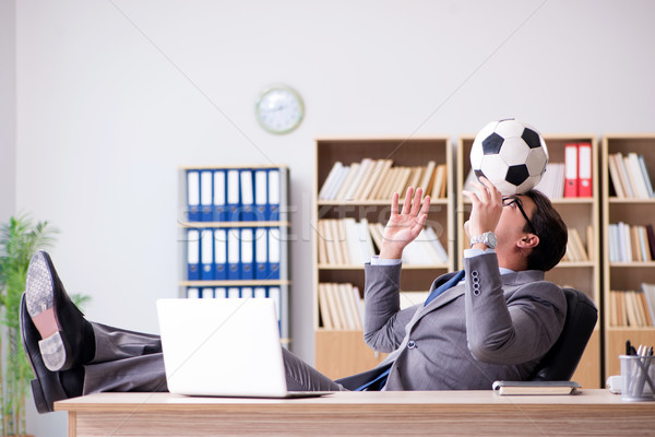 Businessman with football ball in office Stock photo © Elnur