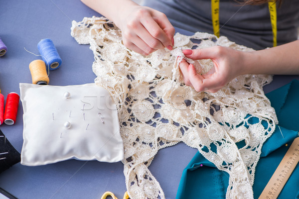 Woman tailor working on a clothing sewing stitching measuring fa Stock photo © Elnur