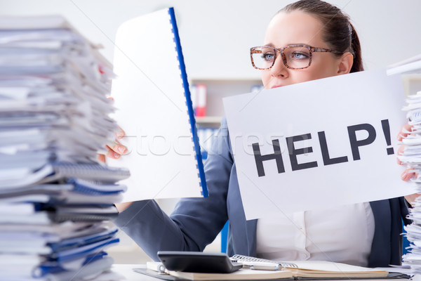 Businesswoman pleading for help in office Stock photo © Elnur