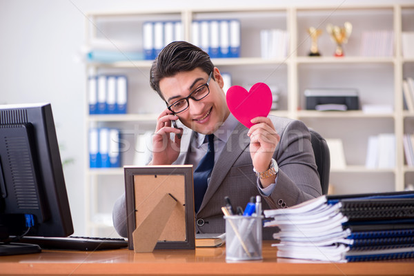 Businessman feeling love and loved in the office Stock photo © Elnur