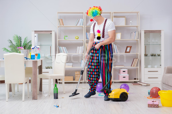 Funny clown doing cleaning at home Stock photo © Elnur