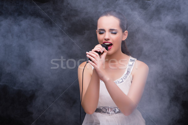 Young girl singing in karaoke club Stock photo © Elnur