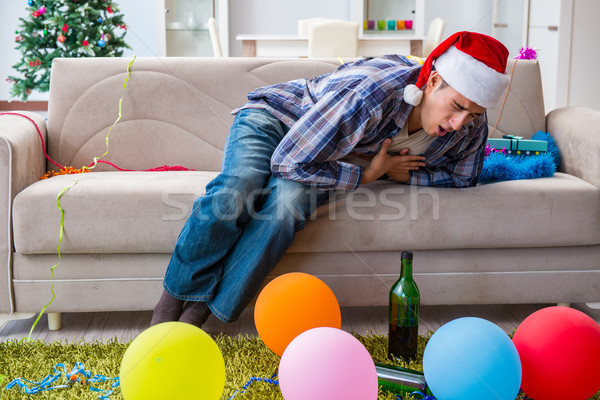 Man having hangover after christmas party Stock photo © Elnur