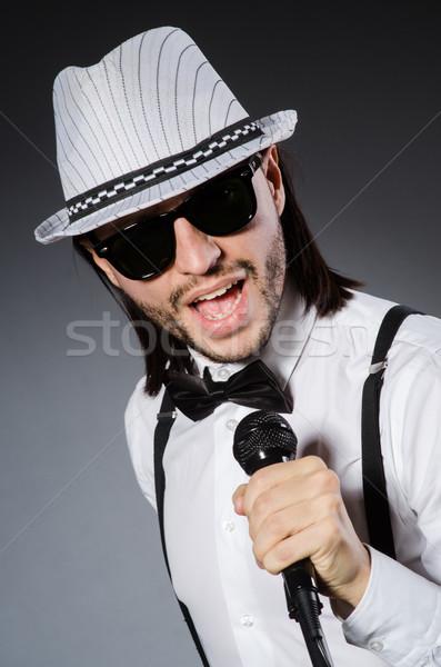 Komik şarkıcı mikrofon konser adam mutlu Stok fotoğraf © Elnur