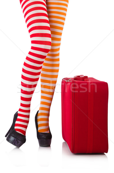 Legs in striped stockings and suitcase isolated on white Stock photo © Elnur