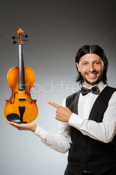 Stock fotó: Férfi · játszik · hegedű · musical · művészet · vicces