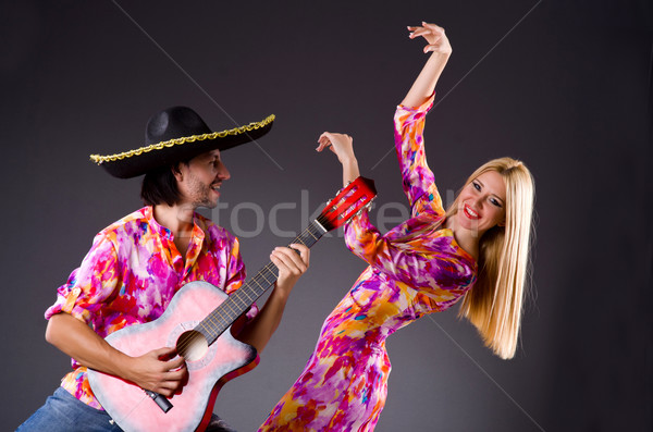 Spanish pair playing guitar and dancing Stock photo © Elnur