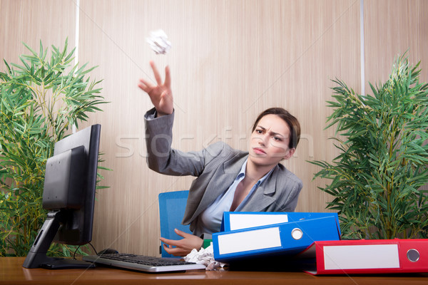 The woman under stress tossing papers in the office Stock photo © Elnur