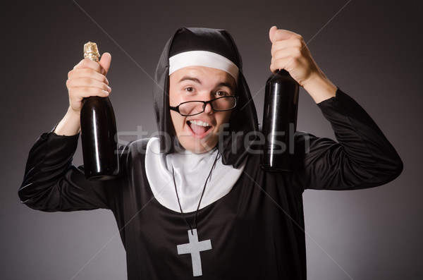 Funny man wearing nun clothing Stock photo © Elnur